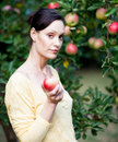 Woman with apple tree Stock Photos