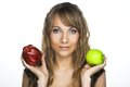 Woman with apples young green and red in fer hands Royalty Free Stock Images