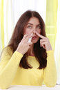 Woman applies nasal spray Stock Photo