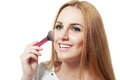 Woman applying blusher portrait of attractive young adult Royalty Free Stock Photography