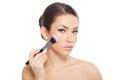 Woman applying blusher young close up Stock Photos