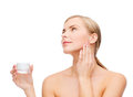 Woman applying cream on her skin cosmetics health and beauty concept beautiful Royalty Free Stock Image