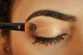Woman applying eyeshadow on her eyes Royalty Free Stock Photo