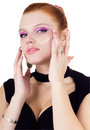 Woman applying foundation on her face Royalty Free Stock Photo