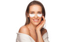 Woman applying gel eye mask Stock Photos