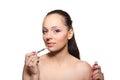 Woman applying gloss for lips. Royalty Free Stock Photo