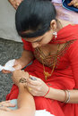 Woman applying Henna Stock Images