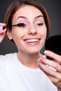 Woman applying make up Royalty Free Stock Photos
