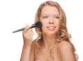 Woman applying makeup Stock Photography