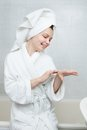 Woman applying moisturizer happy young after bath Royalty Free Stock Photos