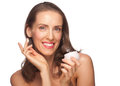 Woman applying moisturizing cream Stock Photo