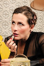 Woman applying red lipstick beautiful retro style Stock Photos