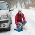Woman applying Snow Chains Royalty Free Stock Photo