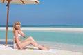 Woman applying sun lotion beach holiday sun Stock Photography