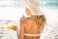 Woman applying sunscreen Royalty Free Stock Photo