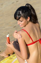 Woman applying suntan lotion in shoulder Stock Images