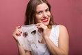 Woman applying a tissue mask beautiful young Stock Photo