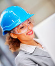 Woman architect with a hard hat and safety glasses Royalty Free Stock Images