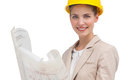 Woman architect smiling with yellow helmet and construction plan Stock Image