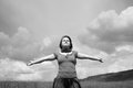 Woman with arms outstretched beautiful sexy in field black and white photo Stock Photos