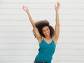 Woman with arms up in the air portrait of a joyful young Royalty Free Stock Photography