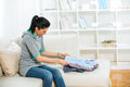 Woman arrange shirts in living room young Royalty Free Stock Photo