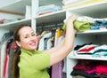 Woman arranging clothes at wardrobe Royalty Free Stock Photo