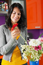 Woman arranging flowers in pot Stock Image