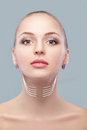 woman with arrows on face neck lifting concept. correction of double chin Royalty Free Stock Photo