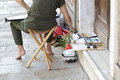 Woman artist painting on the street Royalty Free Stock Photo