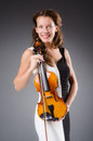 Woman artist with violin in music concept Royalty Free Stock Image