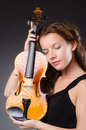 Woman artist with violin in music concept Royalty Free Stock Photo