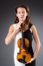 Woman artist with violin in music concept Stock Photography