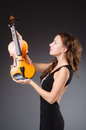 Woman artist with violin in music concept Stock Images