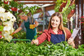 Woman as gardener taking care of plants in a greenhouse Stock Photography