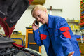 Woman as a mechanic in car workshop Royalty Free Stock Photo