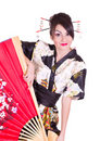 Woman in Asian costume with red Asian fan Royalty Free Stock Image