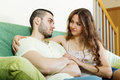 Woman asking for forgiveness from man men after quarrel at home Stock Photos
