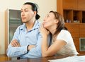 Woman asking for money from husband adult couple having quarrel about documents Stock Photo