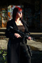 Woman with assault gun Royalty Free Stock Photo