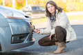 Woman assembling towing hook beautiful to a broken car Royalty Free Stock Image