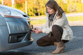 Woman assembling towing hook beautiful to a broken car Royalty Free Stock Photography