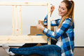 Woman assembling wooden furniture diy using hex key enthusiast young girl doing home improvement Stock Images