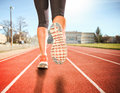 A woman with an athletic pair of legs going for a jog or run dur Royalty Free Stock Photo