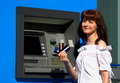 Woman and atm Stock Photo