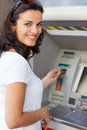 Woman at atm hispanic smiling while withdrawing cash Stock Image