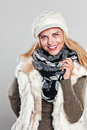 Woman in autumn fashion smiling to the camera on grey Royalty Free Stock Photography