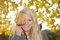 Woman with autumn leave young Stock Images