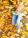 Woman on autumn leaves Royalty Free Stock Images