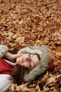 Woman on autumn leaves Stock Image